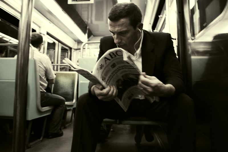 paris_metro man newspaper_more less_small