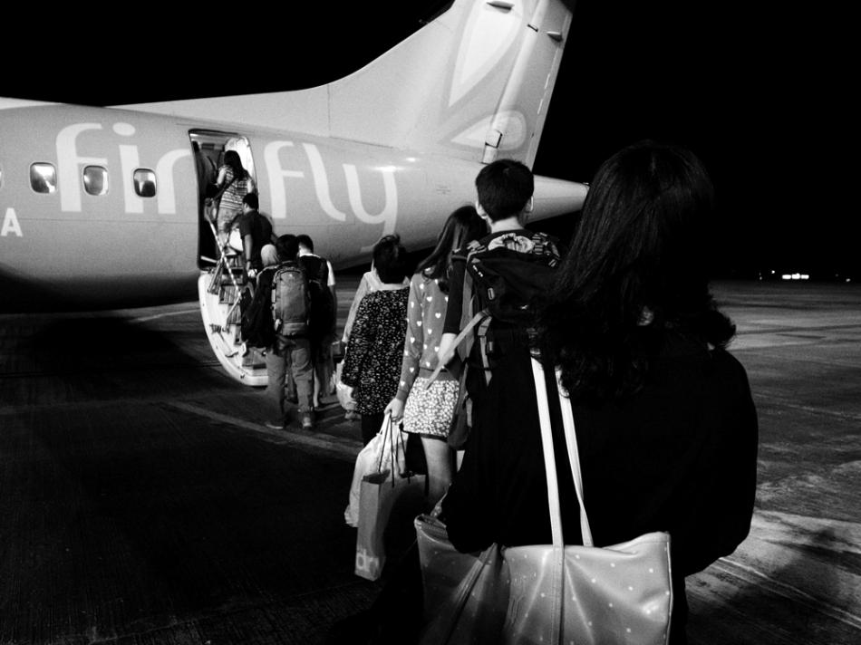 people boarding the flight small
